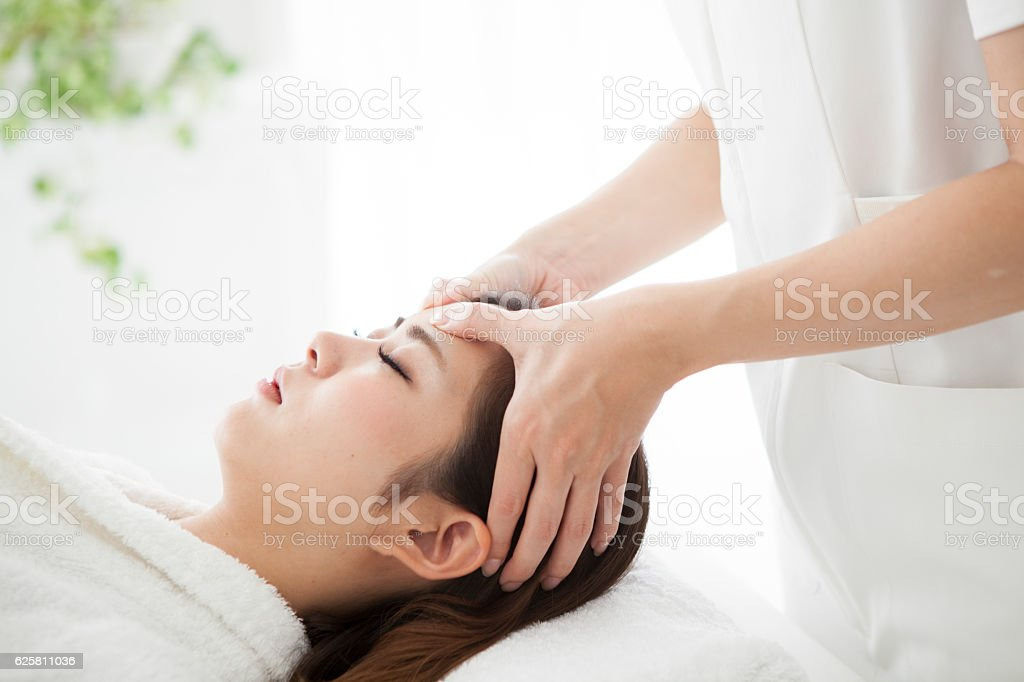 Woman having a head massage for his health stock photo