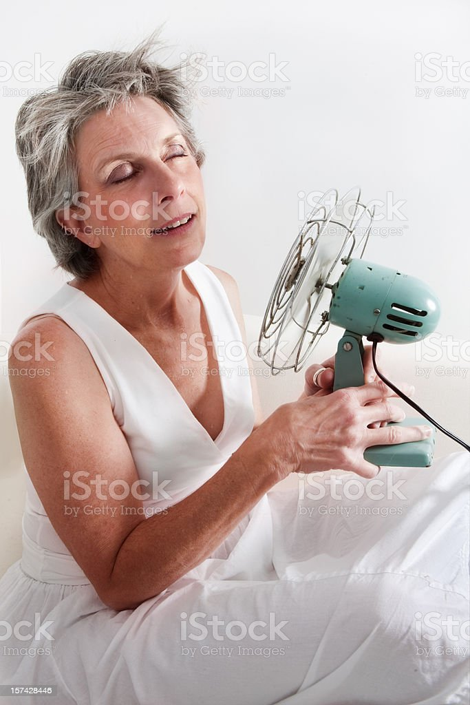woman having a hot flash stock photo