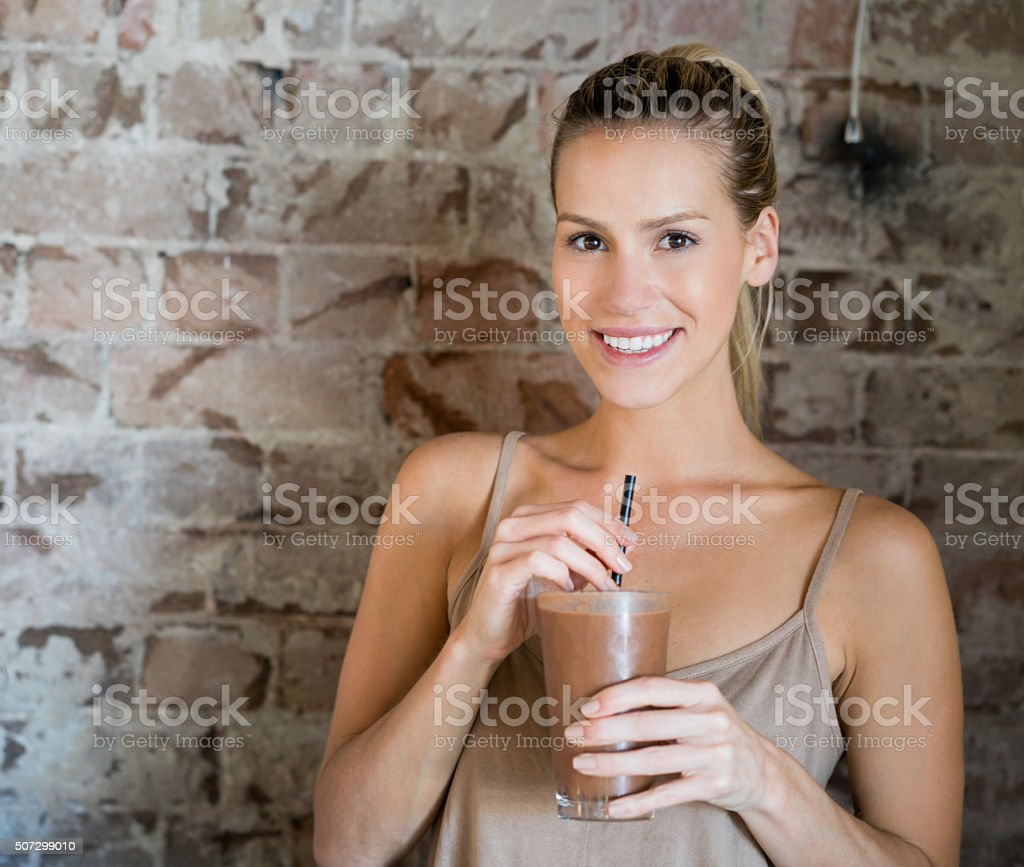 Woman having a milkshake stock photo