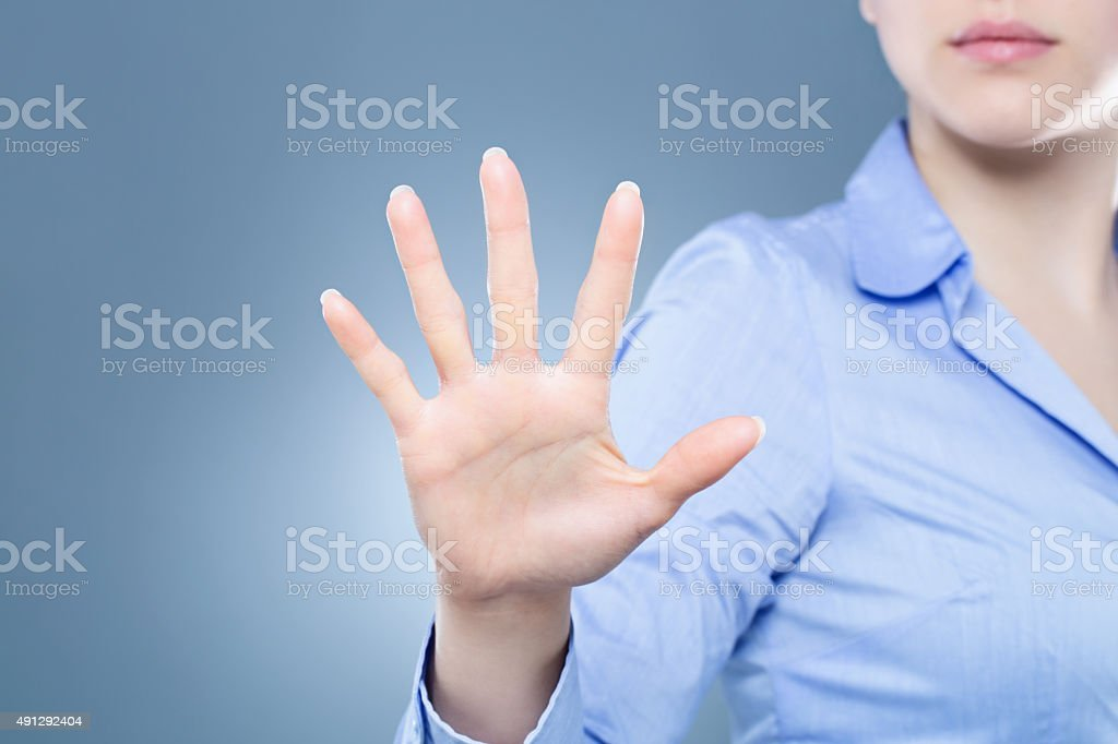 Woman having a palm print identification stock photo