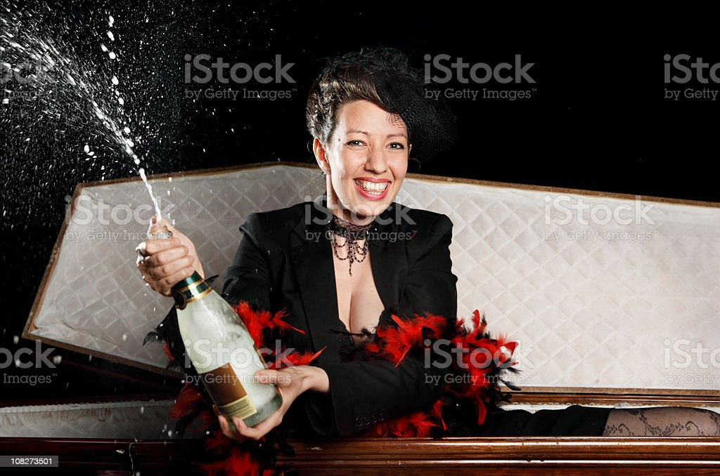 Woman having a party in her Casket royalty-free stock photo