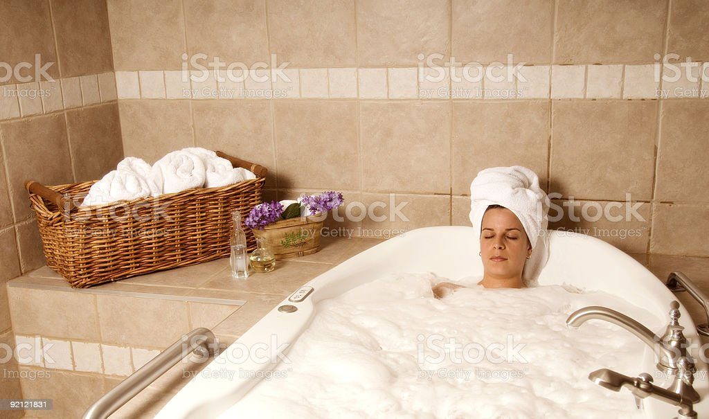 Woman having a relaxing bath with bubbles royalty-free stock photo