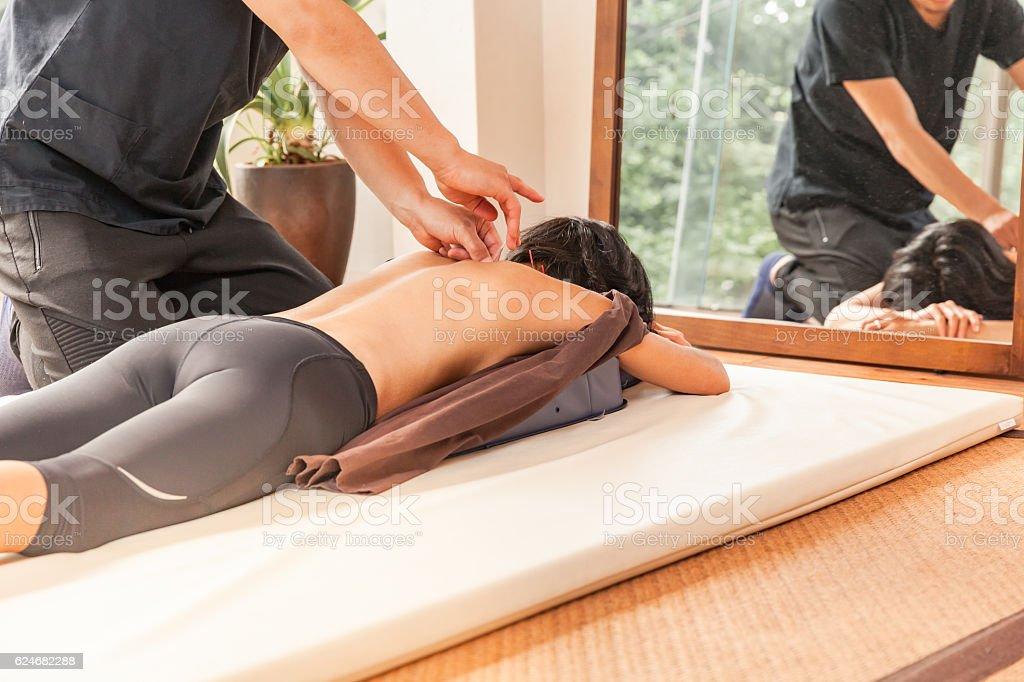 woman having an acupunture session stock photo
