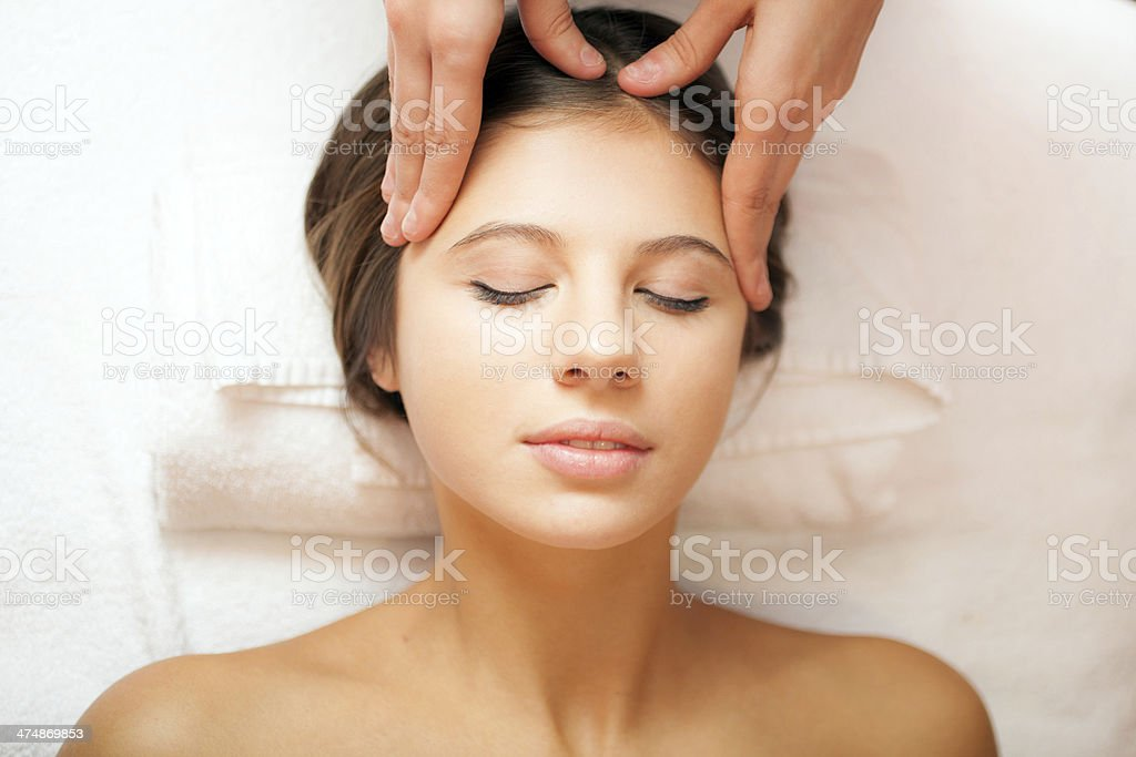 Woman having an head massage stock photo
