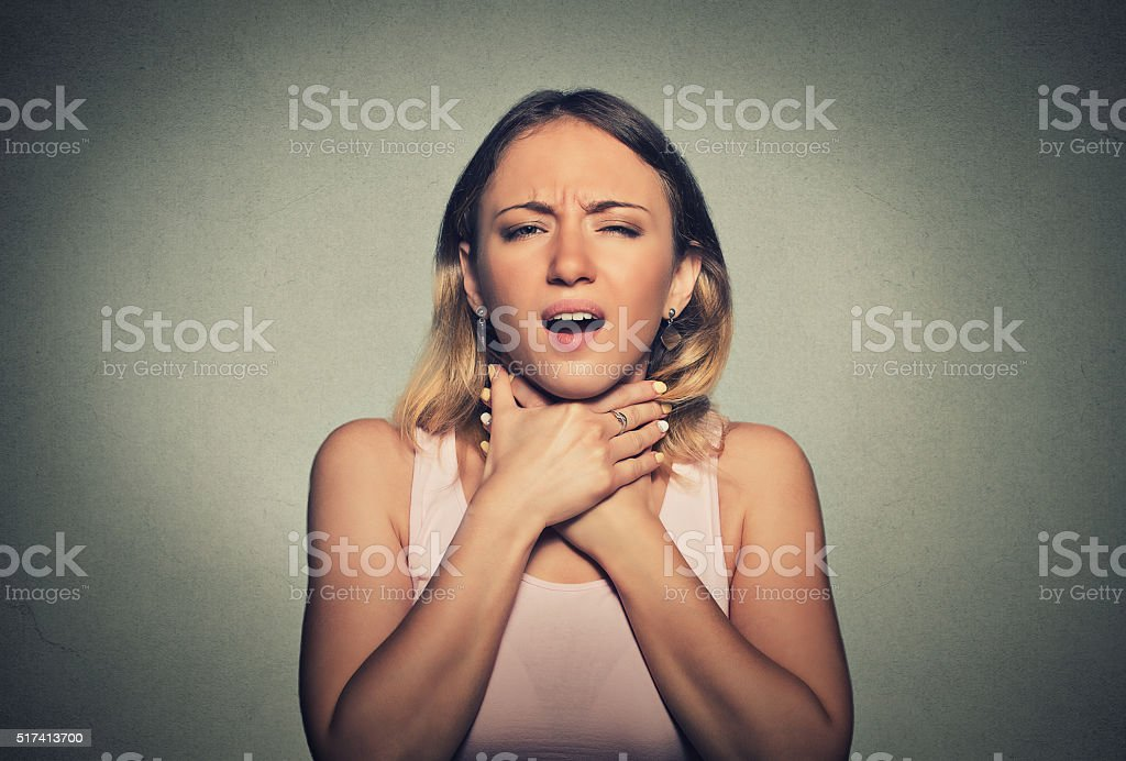 Woman having asthma attack or choking can't breath stock photo
