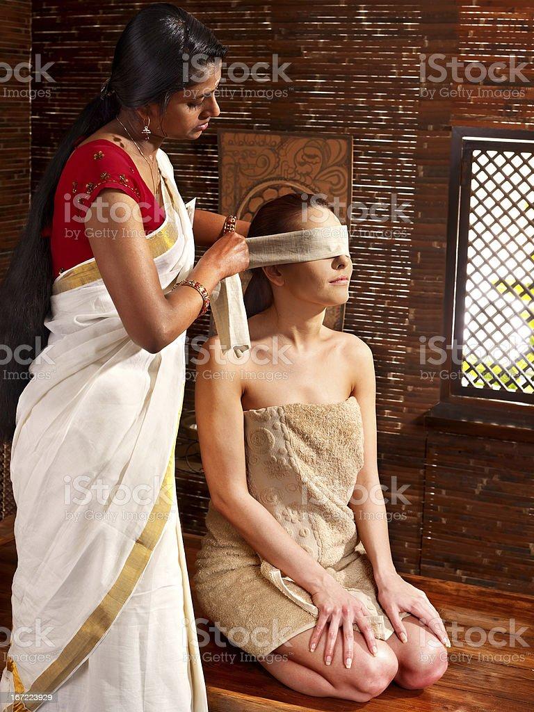Woman having ayurveda spa treatment. royalty-free stock photo