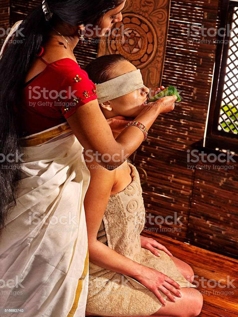 Woman having ayurveda spa treatment stock photo
