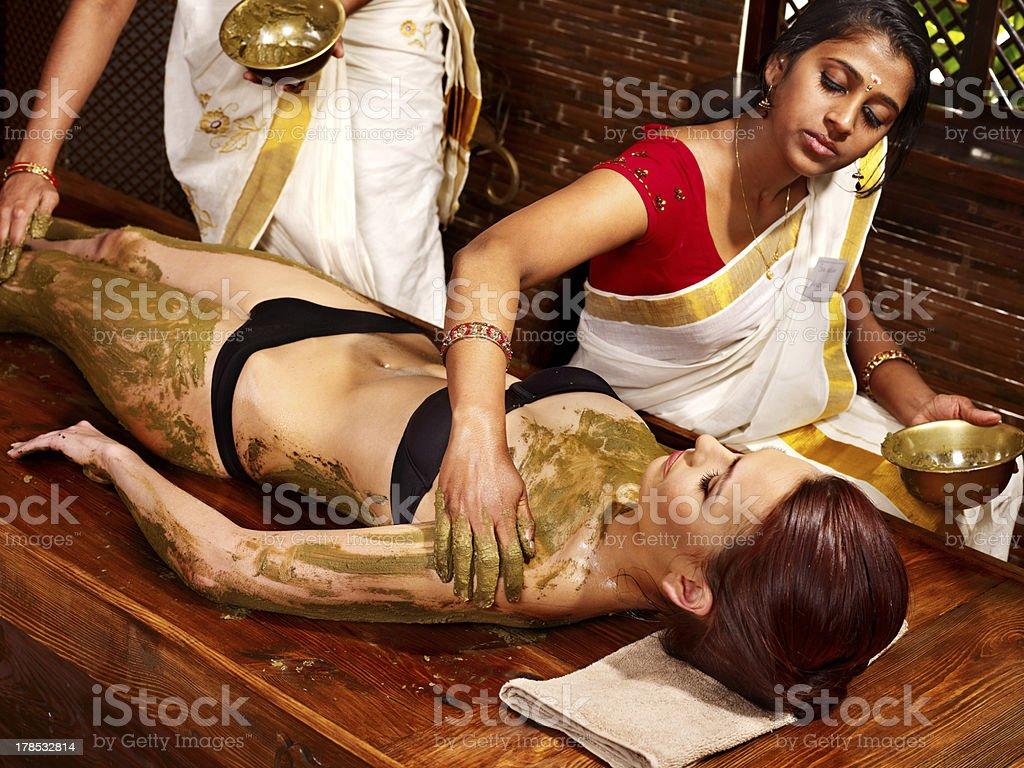 Woman having Ayurvedic body  spa massage. royalty-free stock photo