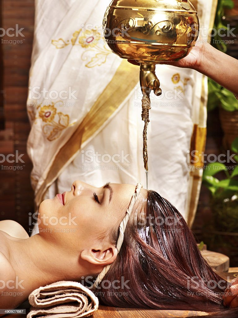 Woman having Ayurvedic spa treatment. stock photo