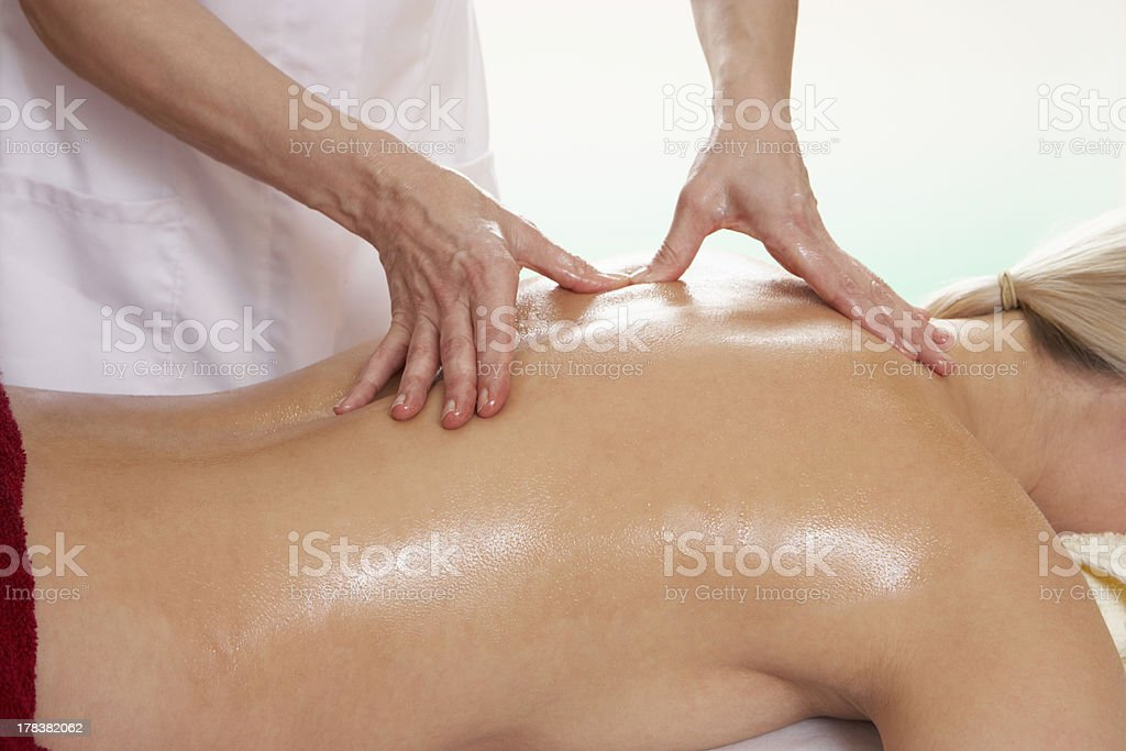 Woman having back massage royalty-free stock photo