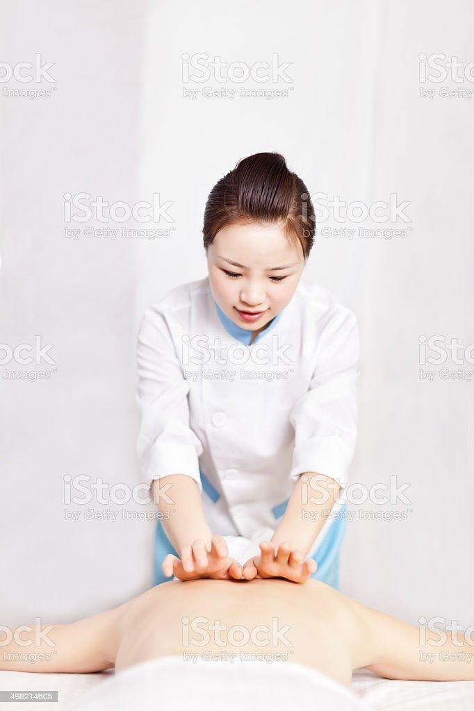 Woman having body massage royalty-free stock photo