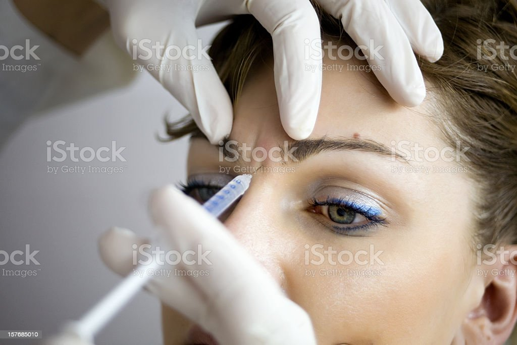 A woman having Botox injections stock photo