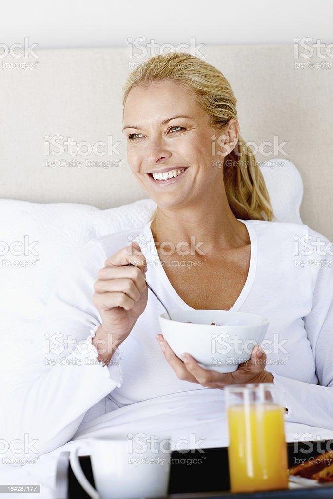 Woman having breakfast in bed royalty-free stock photo