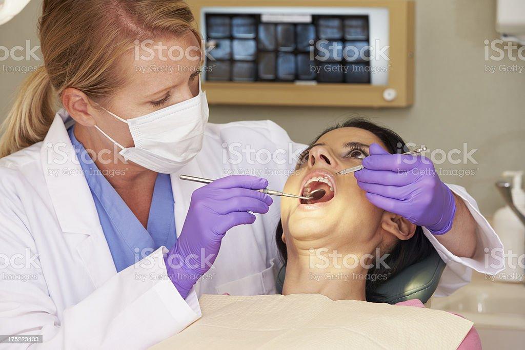 Woman Having Check Up At Dentist royalty-free stock photo
