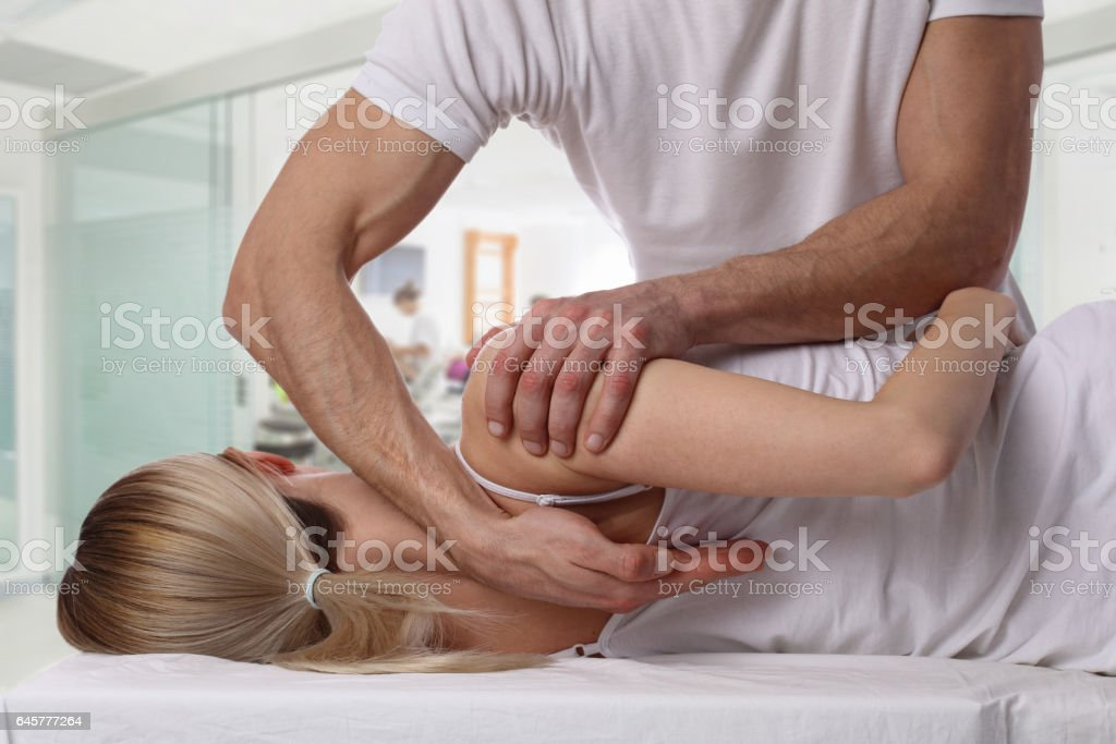 Woman having chiropractic back adjustment. Osteopathy, Alternative medicine, pain relief concept. Physiotherapy, sport injury rehabilitation stock photo