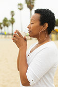 Woman Having Coffee at the Beach