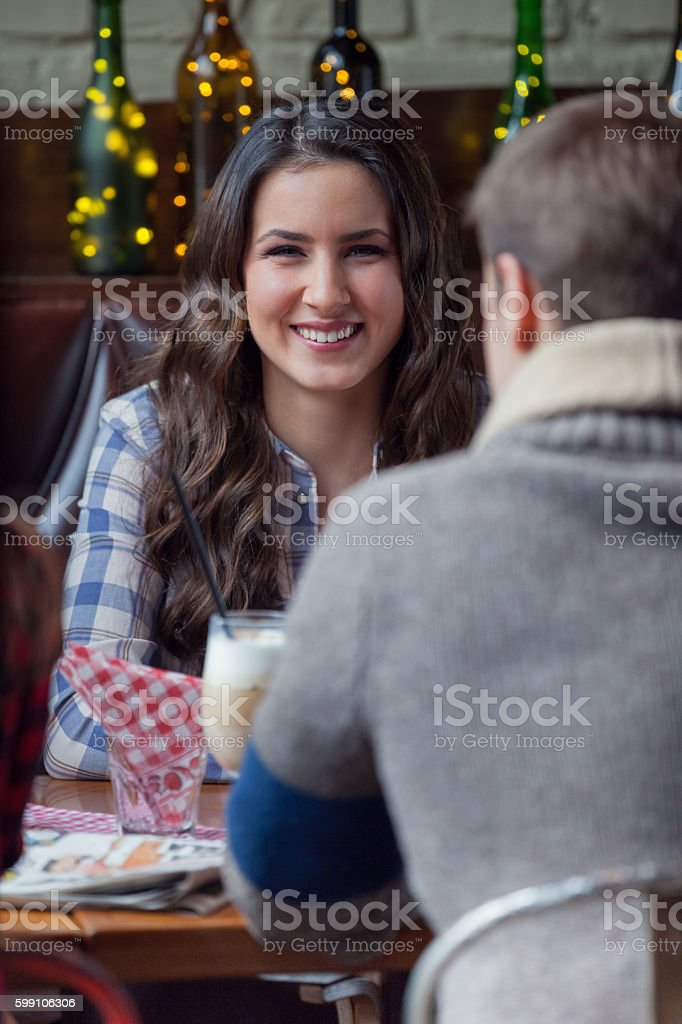 Woman having coffee in cafe stock photo