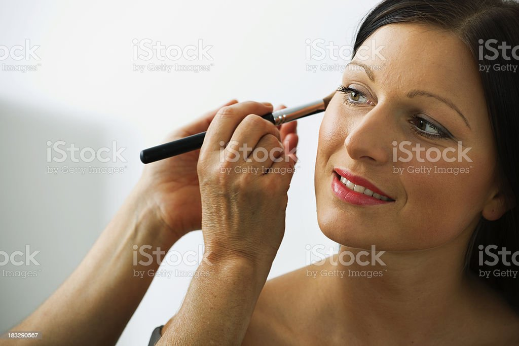 Woman Having Cosmetics Applied royalty-free stock photo