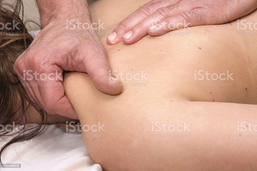 Woman having deep tissue massage stock photo