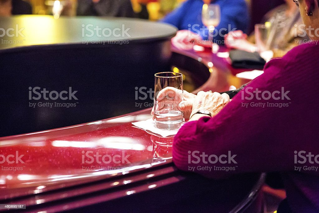 Woman having drinks at piano bar on New year's Eve stock photo