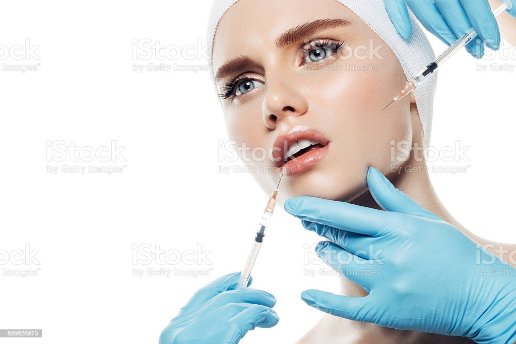 Woman having facial injections stock photo