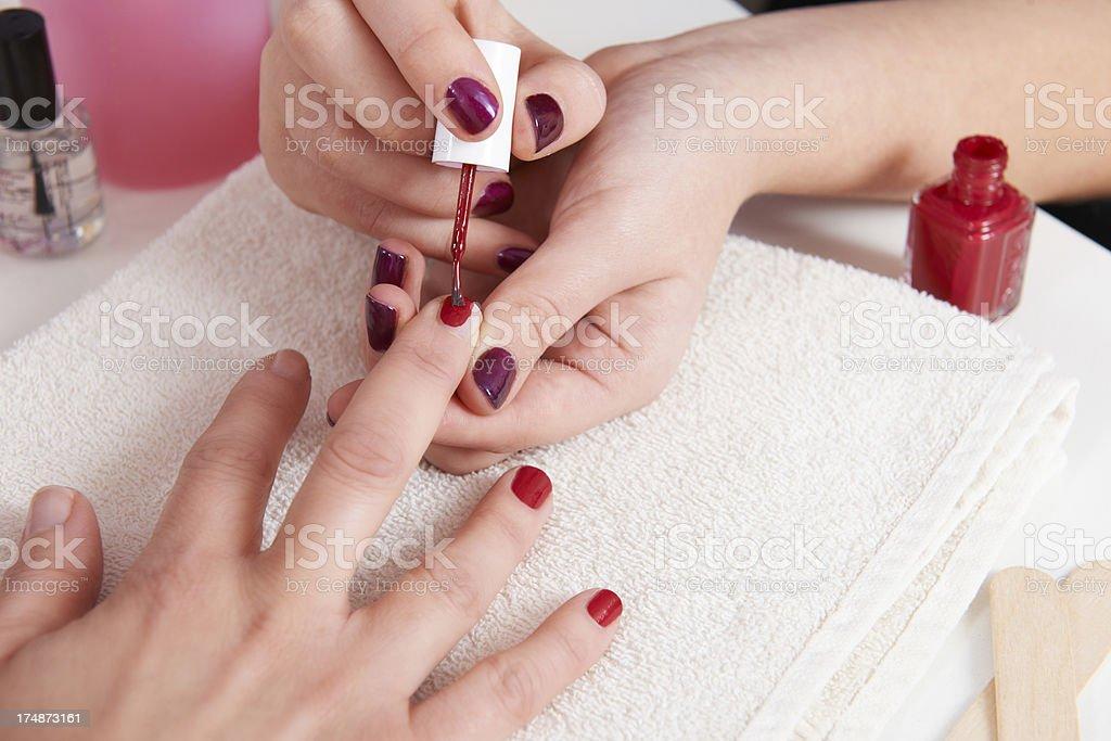 Woman Having Fingernails Painted At Beauty Salon royalty-free stock photo