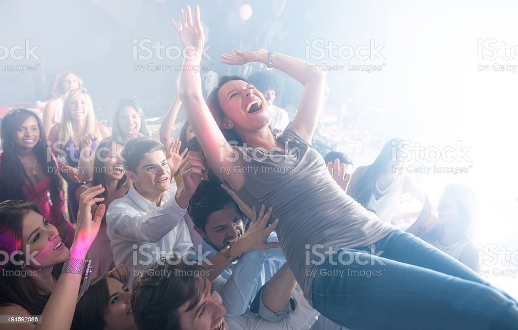 Woman having fun at a concert stock photo