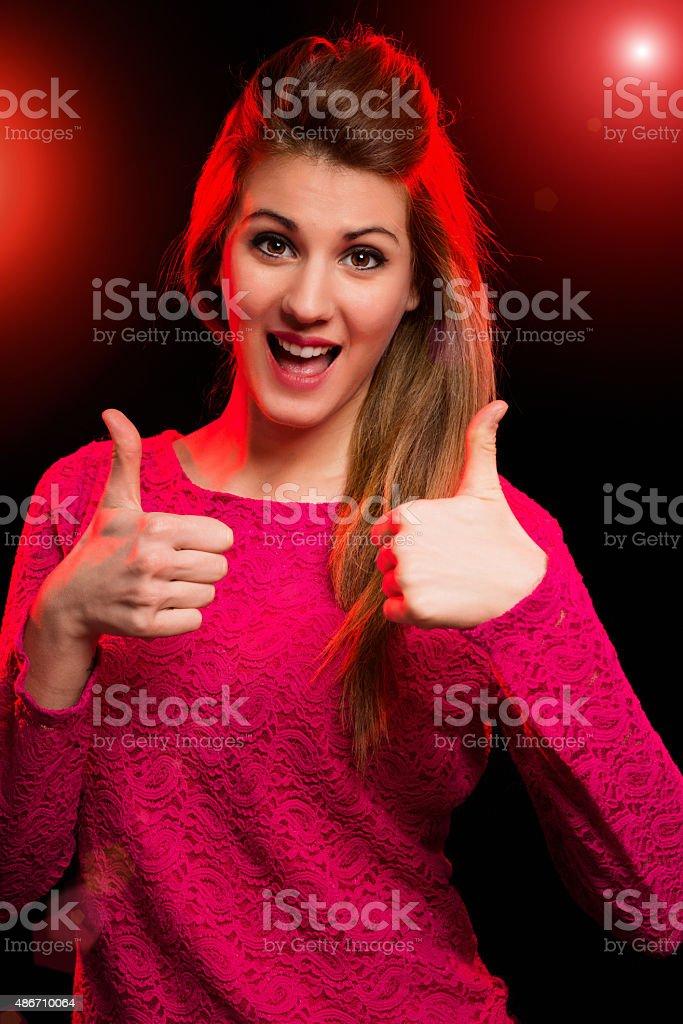 Woman having fun in a discoteque stock photo