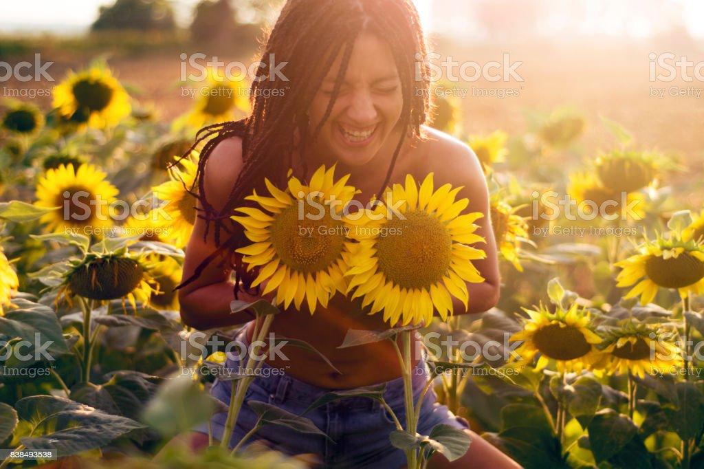 Woman having fun in sunflower field stock photo
