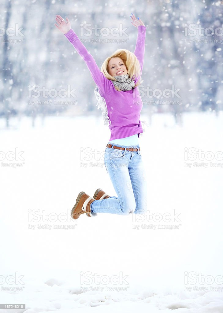 Woman having fun on a snowy day. royalty-free stock photo