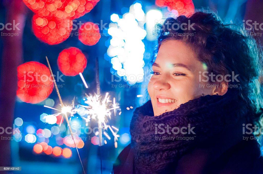 woman having fun with a sparkler stock photo