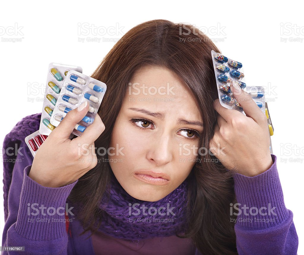 Woman having headache takes pills. royalty-free stock photo