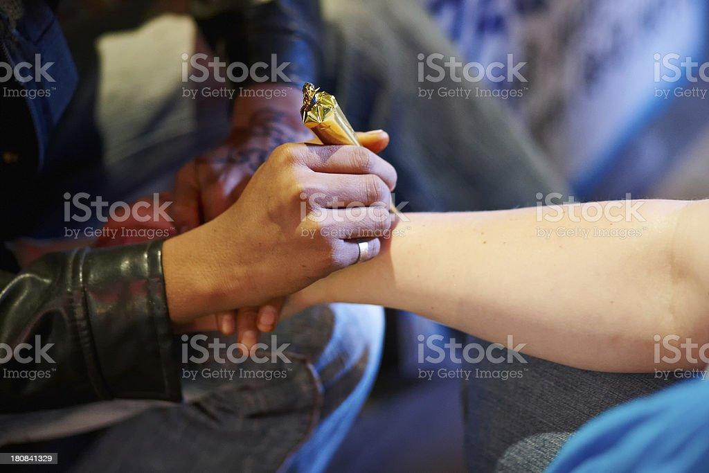 Woman having henna tattoo on Indian street at night royalty-free stock photo
