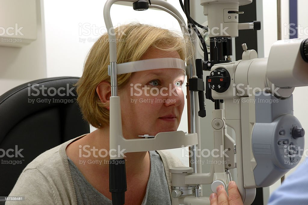 A woman having her eyes tested stock photo