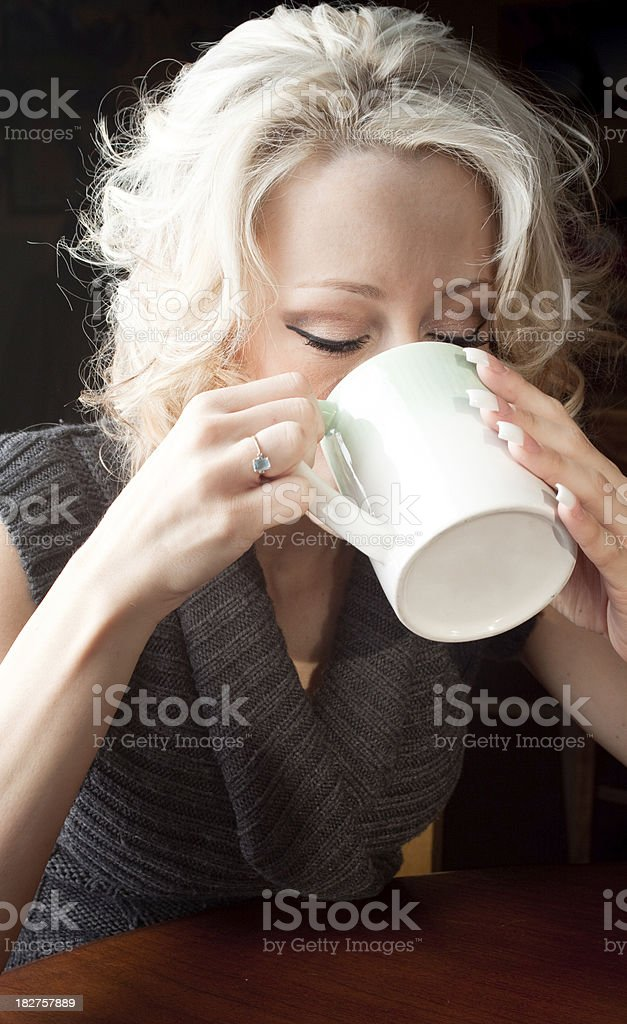 Woman having her morning coffee royalty-free stock photo