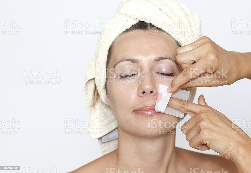 Woman having her upper lip waxed royalty-free stock photo
