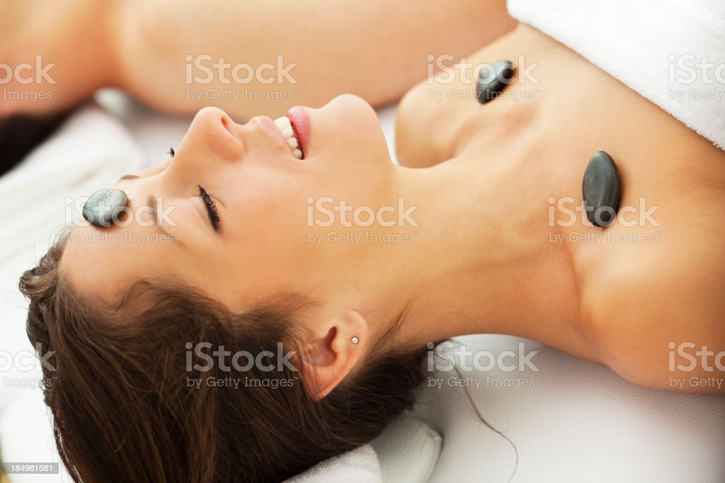 Woman Having Hot Stone Head Massage At Spa Center royalty-free stock photo