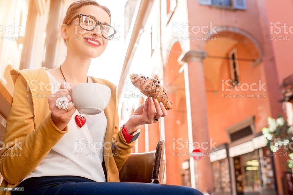 Woman having italian breakfast stock photo