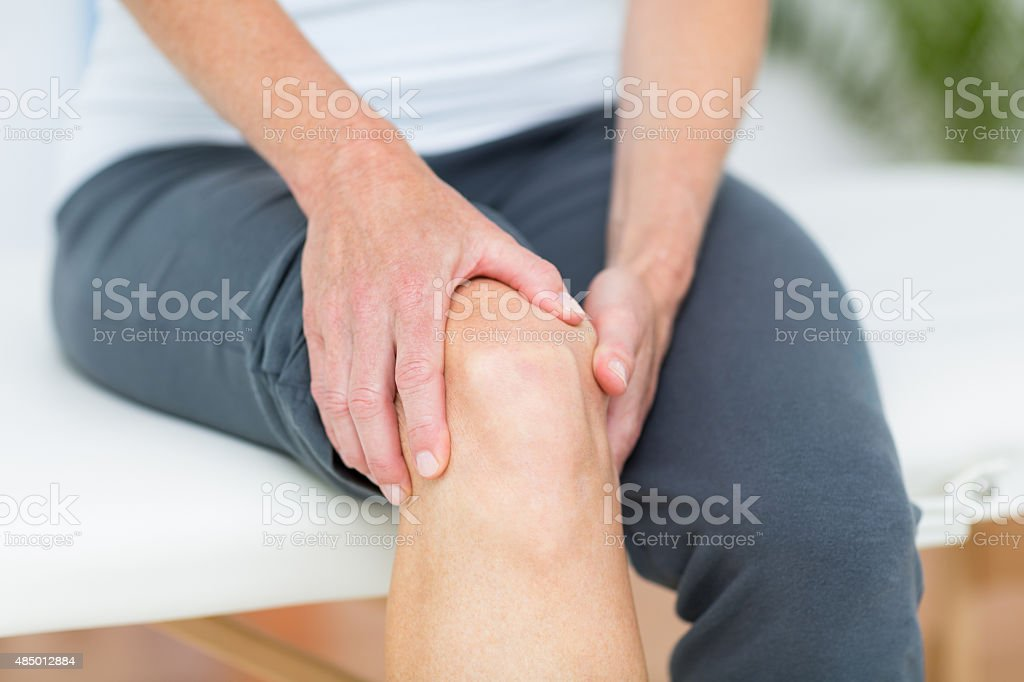 Woman having knee pain stock photo