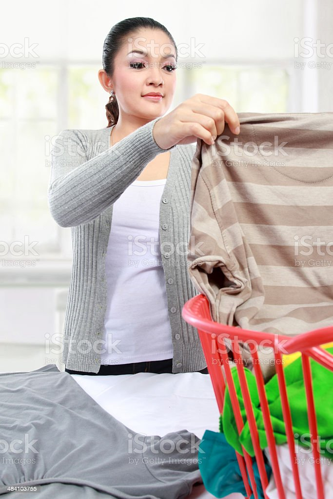 woman having laundry at home stock photo