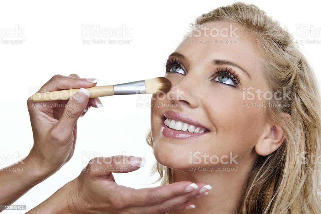 Woman having makeup applied royalty-free stock photo