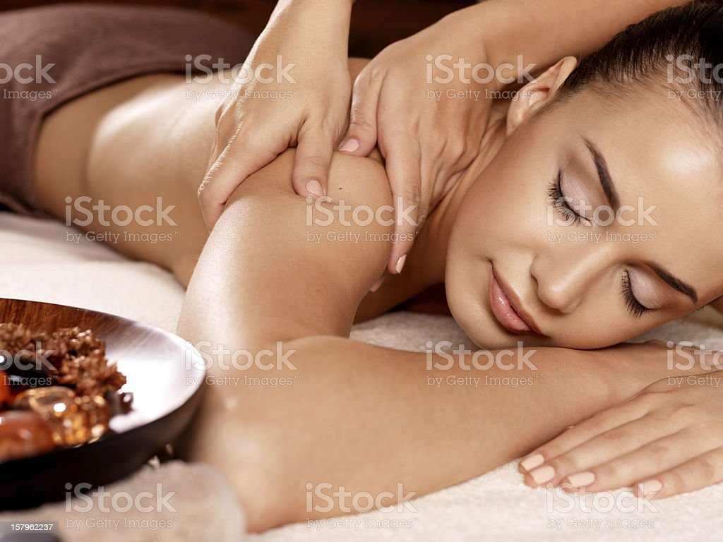 Woman having massage in the spa salon stock photo
