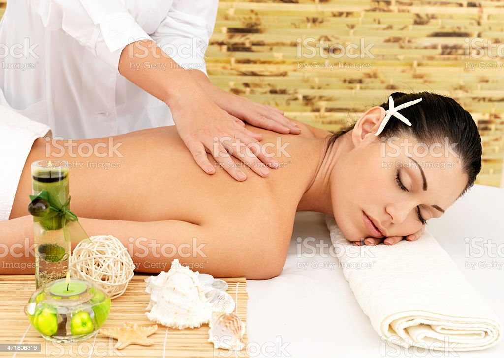 Woman having massage of body in spa salon royalty-free stock photo