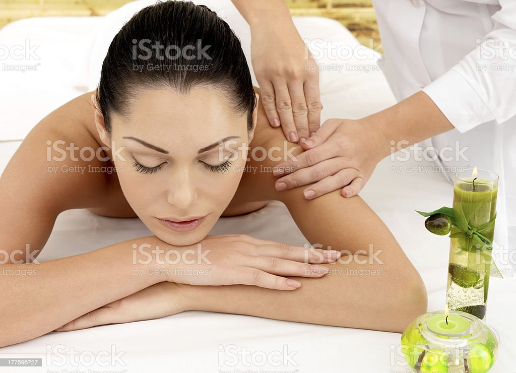 Woman having massage of shoulder in spa salon royalty-free stock photo