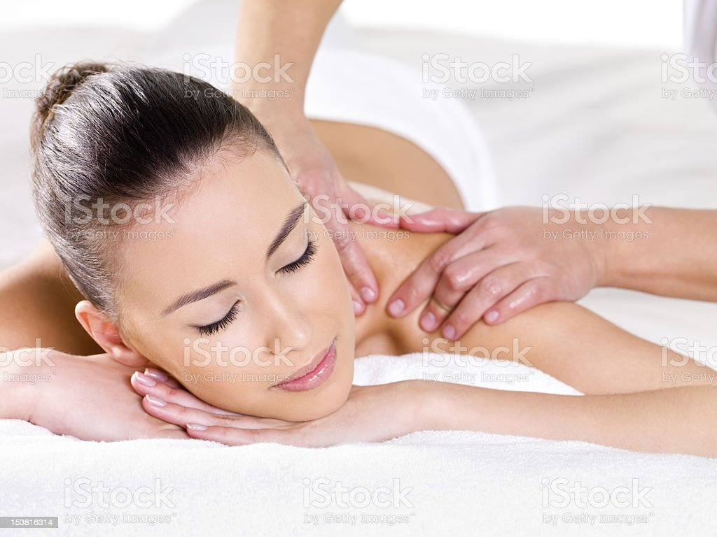 Woman having massage on shoulder royalty-free stock photo