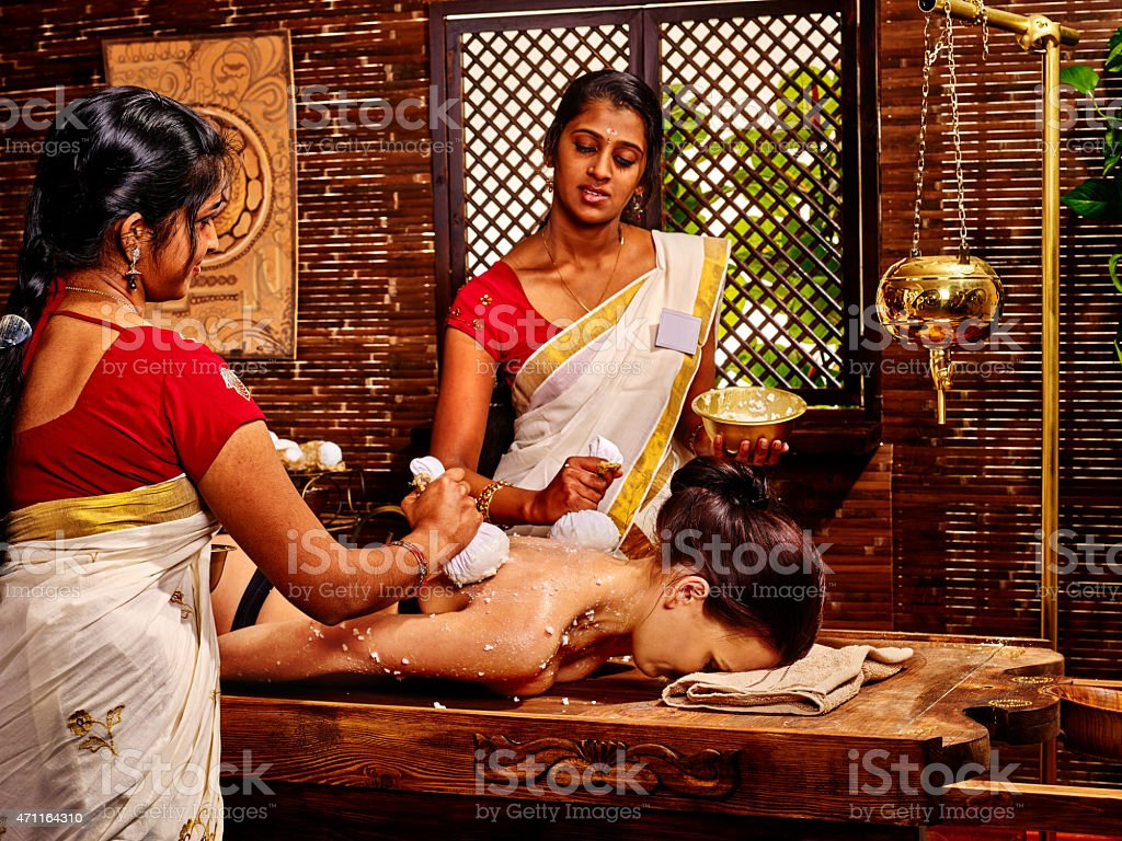 Woman having massage with pouch of rice stock photo