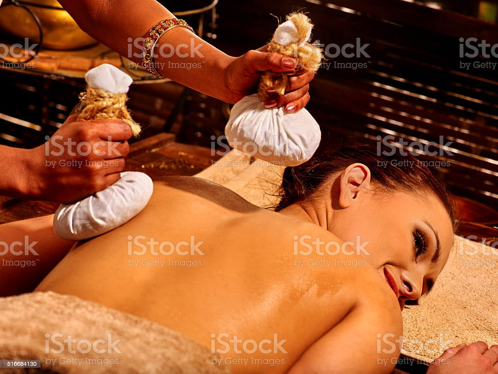 Woman having massage with pouch stock photo