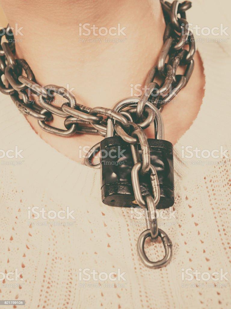 Woman having metal chain around neck stock photo
