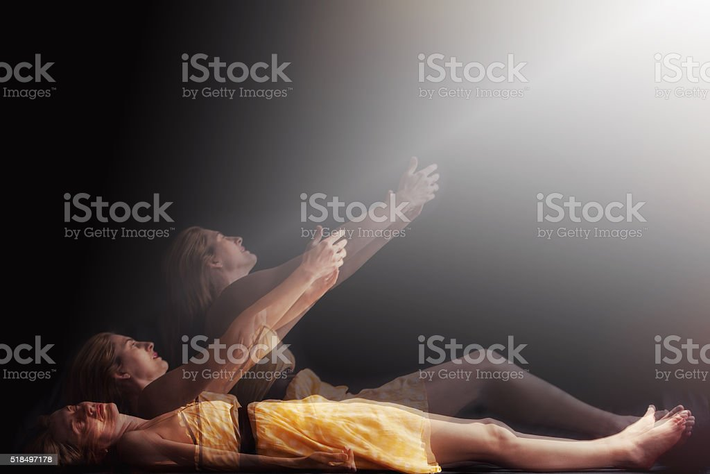 Woman Having Out Of Body Experience stock photo