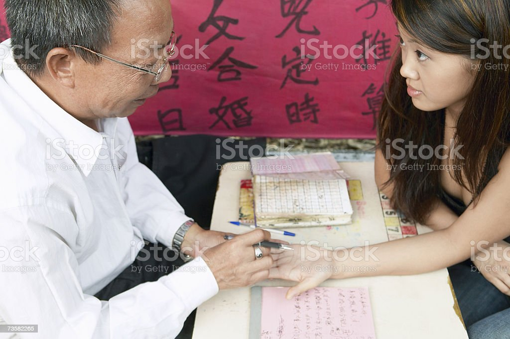 Woman having palm read stock photo